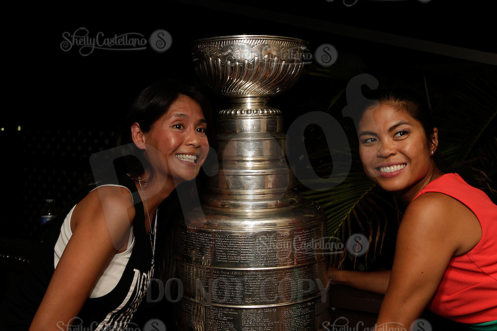 8 September 2014:  NHL Anaheim Kings SPHEM Assistant Equipment Manager Dana Bryson's day with the Stanley Cup in Los Angeles.  Personal Use Only.