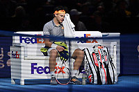 Tennis - 2019 Nitto ATP Finals at The O2 - Day Five<br /> <br /> Singles Group Bjorn Borg: Dominic Thiem (Austria) vs. Matteo Berrettini (Italy)<br /> <br /> Dominic Thiem takes a break during his 2 set defeat to Matteo Berrettini, 7-6, 6-3<br /> <br /> COLORSPORT/ASHLEY WESTERN