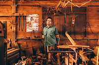 A portrait of Tip at the wood carving factory where she works. Tip began taking hormones to become a woman nearly 20 years ago, but has recently gone off of them, hoping that her breasts will now go away.