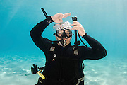Inflate Buoyancy compensator Underwater Hand signs scuba diver demonstrates the sign language for divers.