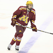Christian Isackson #26 of the Minnesota Gophers is seen on the ice prior to the game against the Northeastern Huskies at Matthews Arena on November 29, 2014 in Boston, Massachusetts. (Photo by Elan Kawesch)