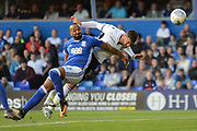 Bolton Wanderers striker Gary Madine (14) heads the ball at goal battling with Birmingham City defender Emilio Nsue (2) 0-0 during the EFL Sky Bet Championship match between Birmingham City and Bolton Wanderers at St Andrews, Birmingham, England on 15 August 2017. Photo by Alan Franklin.