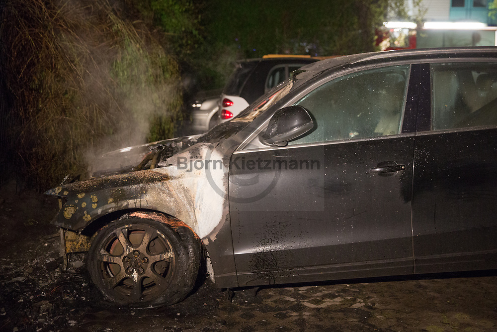 Berlin, Germany - 01.05.2017<br /> <br /> Car arson in Berlin-Wedding. Shortly before midnight a Audi was set on fire in the Maxstrasse. An Opel parked beside was also damaged. The Opel owner was able to drove his car away to prevent larger damage.<br /> <br /> Autobrandstiftung in Berlin-Wedding. In der Maxstrasse wurde kurz vor Mitternacht ein Audi angezuendet ein daneben geparkter Opel wurde ebenfalls beschaedigt. Groe&szlig;ere Schaeden konnte der Opel Besitzer durch umparkte abwenden. <br /> <br /> Photo: Bjoern Kietzmann