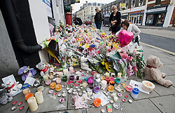 "© under license to London News Pictures.  27/03/2011. Flowers and candles outside SUJU nightclub in Swindon on the day Christopher Halliwell appeared at Swindon magistrates court charged with the murder of 22 year-old Sian O""Callaghan. Photo credit should read: LNP"