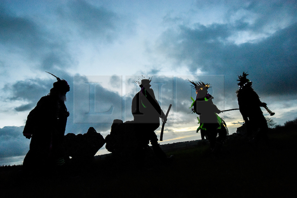 © London News Pictures. 20/12/2015 Rollright Stones, Oxfordshire. Druids and Boerma Morris perform a ceremony for the Winter Solstice celebrations at the Ancient Rollright Stone circle in Oxfordshire as the sun rises.  The groups celebrations took place early this because of solstice falling lose to Christmas day.  Photo credit : Mark Hemsworth/LNP
