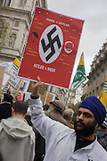Protesters in Whitehall demonstate against the three-day visit to the UK by Indian Prime Minister Narendra Modi. Using the iconography of a swastika, Modi is compared on a placard to Adolf Hitler.
