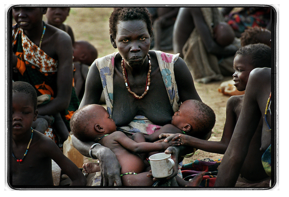 csz980429sudan1c: woman with two children in world vision feeding centre, pre famine conditions in bahr el ghazal regeon of southern sudan threaten the lives of 500,000 people: pic craig sillitoe: story helen signy (smh): news extra melbourne photographers, commercial photographers, industrial photographers, corporate photographer, architectural photographers, This photograph can be used for non commercial uses with attribution. Credit: Craig Sillitoe Photography / http://www.csillitoe.com<br />