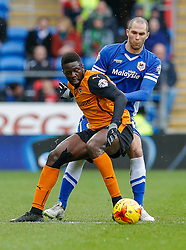 Bakary Sako of Wolverhampton Wanderers is challenged by Matthew Connolly of Cardiff City - Photo mandatory by-line: Rogan Thomson/JMP - 07966 386802 - 28/02/2015 - SPORT - FOOTBALL - Cardiff, Wales - Cardiff City Stadium - Cardiff City v Wolverhampton Wanderers - Sky Bet Championship.