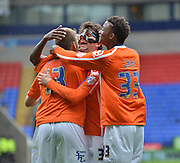 Robert Tesche Diego Fabbrini and Demarai Gray celebrate the opener during the Sky Bet Championship match between Bolton Wanderers and Birmingham City at the Macron Stadium, Bolton, England on 2 May 2015. Photo by Mark Pollitt.