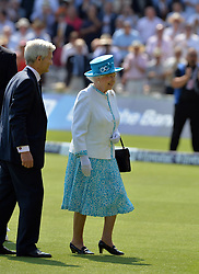 © Licensed to London News Pictures. 18/07/2013. Queen Elizabeth II is leaves the pitch after meeting the teams prior to day one of  Second Test England v Australia The Ashes Lord's Cricket Ground, London 18/07/2013<br /> . Photo credit: Mike King/LNP