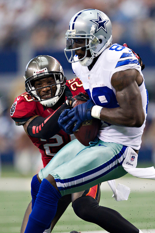 DALLAS, TX - SEPTEMBER 23:  Dez Bryant #88 of the Dallas Cowboys is tackled by Aqib Talib #25 of the Tampa Bay Buccaneers at Cowboys Stadium on September 23, 2012 in Dallas, Texas.  The Cowboys defeated the Buccaneers 16-10.  (Photo by Wesley Hitt/Getty Images) *** Local Caption *** Dez Bryant; Aqib Talib
