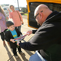 Eli Wilson, 4, of New Albany, hands Dodson, of Z98.5 and the Mississippi Radio Group, a handful of children's books in exchange for Monster Jam tickets Friday morning at the BancorpSouth Arena. A donation of one book received one complimentary ticket voucher while supplies lasted with the books being collected going to The United Way of Northeast Mississippi.