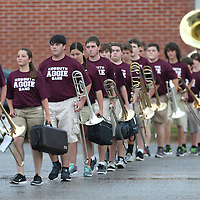 Lauren Wood | Buy at photos.djournal.com<br /> Members of the Kossuth High School marching band walk through the parking lot to the stadium before Friday night's game against Pontotoc.