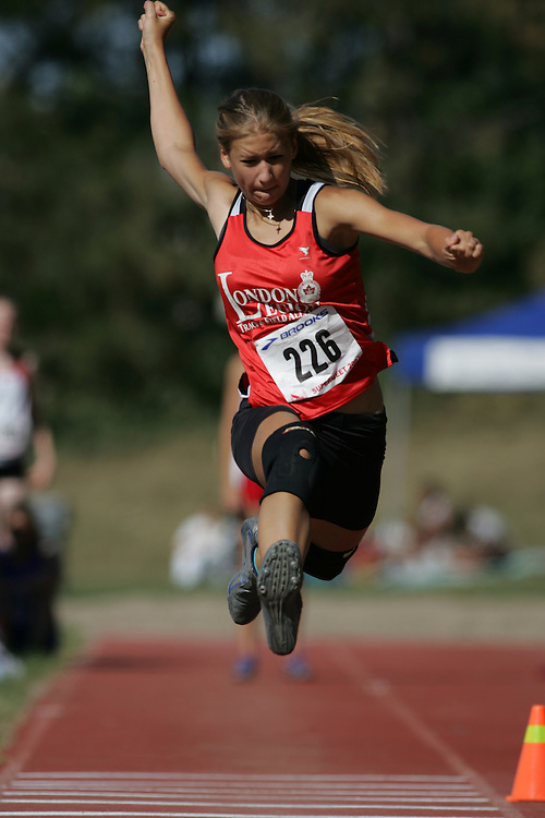 Kristin Bujnowski competing in the midget girls triple jump at the 2007 OTFA Supermeet II. The Ontario Track and Field Association Bantam-Midget-Juvenile Championships were held in Toronto from August 3rd to 5th.