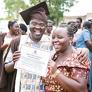 CAPTION: World Renew Uganda's Edward Okiror and his wife show just how excited they feel, after Edward receives his TLT Master Trainer Certification certificate. LOCATION: Kaberamaido, Kaberamaido District, Uganda. INDIVIDUAL(S) PHOTOGRAPHED: Edward Okiror (left) and unknown (right).