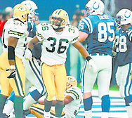 (Published caption 11/17/97) Packers safety LeRoy Butler displays his emotion after tackling Colts tight end Ken Dilger (85) at the 1-yard line to set up Indianapolis' game-winning field goal.