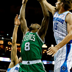 Mar 20, 2013; New Orleans, LA, USA; New Orleans Hornets center Robin Lopez (15) blocks a shot by Boston Celtics power forward Jeff Green (8) during the second half of a game at the New Orleans Arena. The Hornets defeated the Celtics 87-86. Mandatory Credit: Derick E. Hingle-USA TODAY Sports