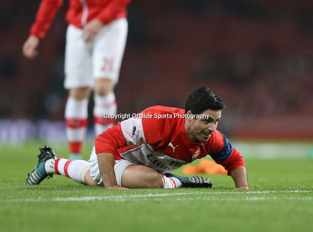 22 November 2014 - Barclays Premier League - Arsenal v Manchester United - Mikel Arteta of Arsenal stretches during the warm up - Photo: Marc Atkins / Offside.