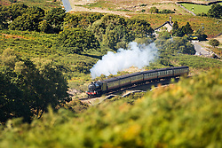 © Licensed to London News Pictures. 01/10/2015. Goathland, UK. Picture shows the Great Marquess steam train travelling through the North Yorkshire Moors on the Goathland to Pickering line on another sunny afternoon in Yorkshire. Photo credit: Andrew McCaren/LNP