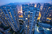 An overview of a flagship low-income housing, where China is pushing ahead with its  history-making plan to move rural residents into towns and cities.<br /> <br /> Newly resettled farmers are mixed with migrant workers and students in this project in one of the fastest-growing and biggest cities on earth, with a population of 29 million. <br /> <br /> Moving farmers to urban areas is touted as a way of changing China&rsquo;s economic structure, with growth based on domestic demand for products instead of exporting them. In theory, new urbanites mean vast new opportunities for construction firms, public transportation, utilities and appliance makers, and a break from the cycle of farmers consuming only what they produce.<br /> <br /> Urbanization has already proven to be one of the most wrenching changes in China&rsquo;s 35 years of economic reforms. Land disputes rising from urbanization account for tens of thousands of protests each year.