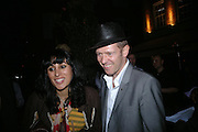 Serena Rees and  Paul Simonon. Tracey Emin's ' When I Think about Sex' exhibition after-party. Momo. Heddon St. London. 26 May 2005. ONE TIME USE ONLY - DO NOT ARCHIVE  © Copyright Photograph by Dafydd Jones 66 Stockwell Park Rd. London SW9 0DA Tel 020 7733 0108 www.dafjones.com