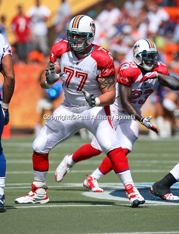 HONOLULU, HI - FEBRUARY 08: AFC All-Stars offensive tackle Jake Long #77 of the Miami Dolphins blocks against the NFC All-Stars in the 2009 NFL Pro Bowl at Aloha Stadium on February 8, 2009 in Honolulu, Hawaii. The NFC defeated the AFC 30-21. ©Paul Anthony Spinelli *** Local Caption *** Jake Long