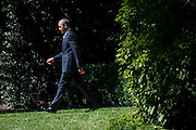 """President Barack Obama makes his way to Marine One on the South Lawn of the White House as he travels to join Education Secretary Arne Duncan for his sixth annual """"Back-to-School bus tour,"""" in Des Moines, Iowa U.S., on Monday, Sept. 14, 2015.  Obama and Duncan will host a town hall at North High School to discuss college access and affordability as well as changes to the college financial aid system to allow more flexible deadlines. Photo: Pete Marovich/Bloobmerg/Pool"""