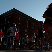 Runners make their way down Front Stree during the Wilmington Family YMCA 32nd Annual Tri-Span 10K and 5K Saturday July 12, 2014 in Wilmington, N.C. (Jason A. Frizzelle)