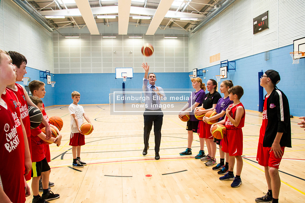 Pictured: Michael Matheson tries his luck from the free throw line<br /> Today, Justice Secretary Michael Matheson visited the Raploch community campus and met young people involved in CashBack-funded basketball sessions. <br />  <br /> Ger Harley | EEm 11 July  2017