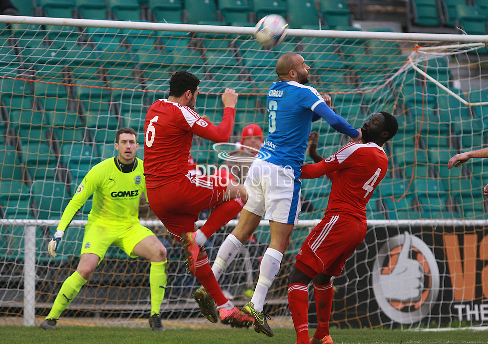 Whitehawk defender Jordan Rose and Dover defender Richard Orlu compete for a high ball during the FA Trophy match between Whitehawk FC and Dover Athletic at the Enclosed Ground, Whitehawk, United Kingdom on 12 December 2015. Photo by Bennett Dean.