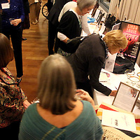People browse auction items during Starry, Starry Night Friday November 15, 2013 at Cameron Art Museum. (Jason A. Frizzelle)