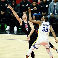 LOS ANGELES, CA - APR 26: Danilo Gallinari (8) of the LA Clippers shoots the ball against Kevin Durant (35) of the Golden State Warriors during Game 6 of the Western Conference First Round on April 26, 2019 at the Staples Center, in Los Angeles, California.
