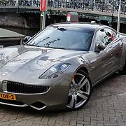 NLD/Amsterdam/20120424 - Electrische auto Fysker van Pr. Maurits word opgeladen op een graht in Amsterdam maar houd wel 2 parkeerplekken bezet,