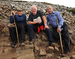 Men on the mountain Padraig McHale, Tom Prendergast Ballintubber and Michael Hastings pictured on their way up Croagh Patrick during the annual pilgrimage on sunday last. <br /> Pic Conor McKeown