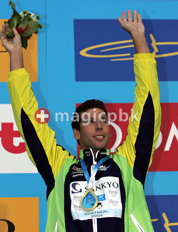 Australia's Grant Hackett celebrates on the victory stand after winning the gold medal in the men's 1500m Frestyle at the FINA World Championships in Montreal, Canada Sunday 31 July, 2005.  (Photo by Patrick B. Kraemer / MAGICPBK)