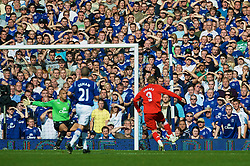 LIVERPOOL, ENGLAND - Saturday, September 27, 2008: Liverpool's Fernando Torres scores the opening goal against Everton during the 208th Merseyside Derby match at Goodison Park. (Photo by David Rawcliffe/Propaganda)