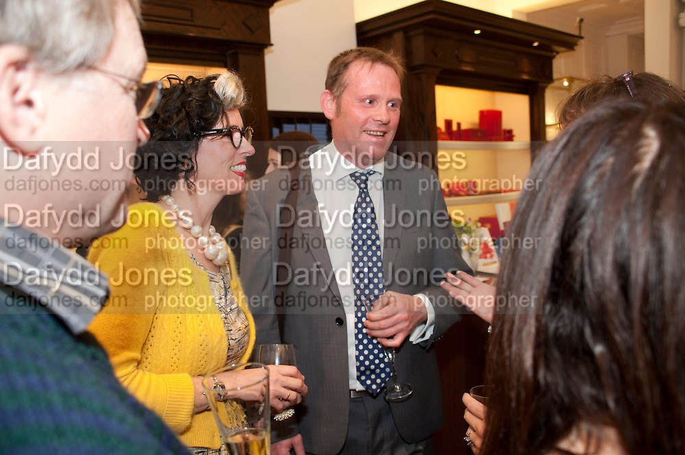 LINDSAY TAYLOR; WARREN FRESLE, Smythson Royal Wedding exhibition preview. Smythson together with Janice Blackburn has commisioned 5 artist designers to create their own interpretations of  Royal wedding memorabilia. Smythson. New Bond St. London. 5 April 2011.  -DO NOT ARCHIVE-© Copyright Photograph by Dafydd Jones. 248 Clapham Rd. London SW9 0PZ. Tel 0207 820 0771. www.dafjones.com.