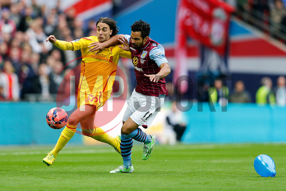 Lazar Markovic of Liverpool is challenged by Kieran Richardson of Aston Villa as a balloon sits on the Wembley pitch - Photo mandatory by-line: Rogan Thomson/JMP - 07966 386802 - 19/04/2015 - SPORT - FOOTBALL - London, England - Wembley Stadium - Aston Villa v Liverpool - FA Cup Semi Final.