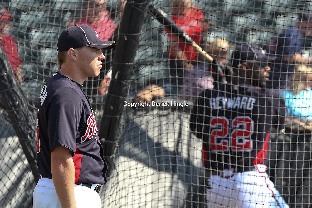 March 16, 2011; Lake Buena Vista, FL, USA; Atlanta Braves first baseman Freddie Freeman (5) watches as teammate Jason Heyward (22) takes batting practice before a spring training exhibition game against the Boston Red Sox at the Disney Wide World of Sports complex.  Mandatory Credit: Derick E. Hingle