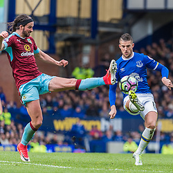Burnley midfielder George Boyd (21) and Everton forward Kevin Mirallas (11) challenge for a loose ball in the Premier League match between Everton and Burnley<br /> (c) John Baguley | SportPix.org.uk