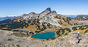 The volcanic pinnacle of Black Tusk (2319 m or 7608 ft) rises above Mimulus Lake, Black Tusk Lake, and Helm Lake (left to right), seen from Panorama Ridge Trail. The Black Tusk is a remnant of an extinct andesitic stratovolcano which formed 1.3-1.1 million years ago: after long glacial erosion, renewed volcanism 170,000 years ago made the lava flow and dome forming the tooth-shaped summit. The top of Panorama Ridge is 17 miles round trip with 5100 feet gain from Rubble Creek parking lot (or 6 miles/10k RT with 2066 ft/630m gain from either Taylor Meadows or Garibaldi Lake Backcountry Campground). A hiking loop to Garibaldi Lake via Taylor Meadows Campground is 11 miles (18k) round trip, with 3010 ft (850m) gain. Garibaldi Provincial Park is east of the Sea to Sky Highway (Route 99) between Squamish and Whistler in the Coast Range, British Columbia, Canada. This panorama was stitched from 12 overlapping images.