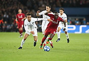 Sadi Mane of Liverpool against Thilo Kehrer of Paris Saint-Germain during the Champions League group stage match between Paris Saint-Germain and Liverpool at Parc des Princes, Paris, France on 28 November 2018.