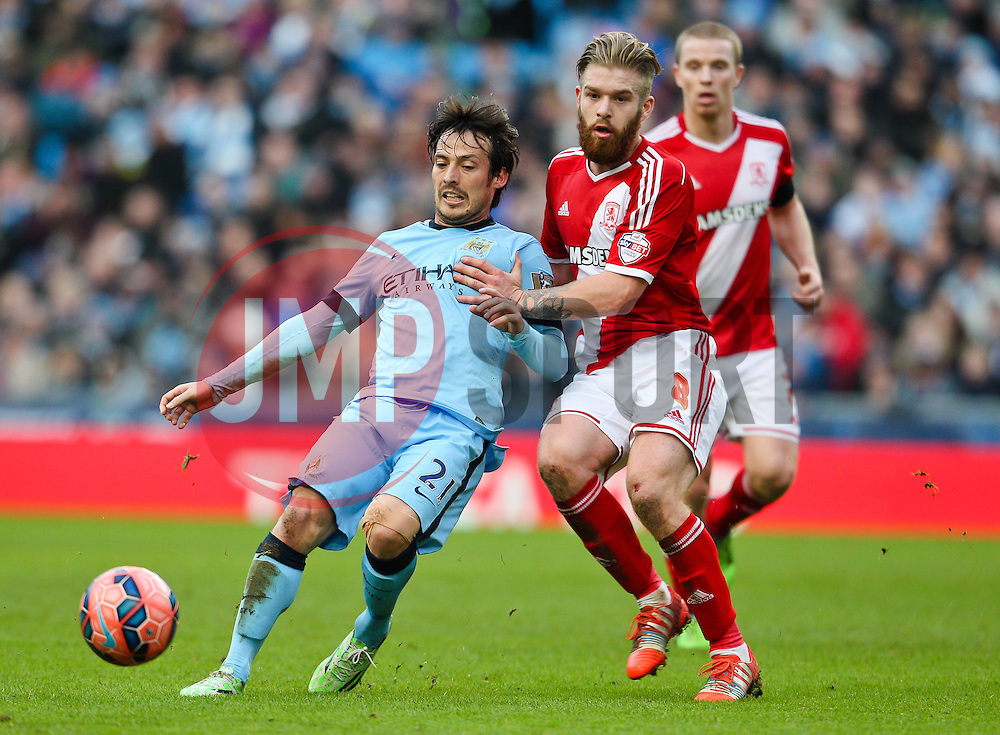 Manchester City's David Silva is closed down by Middlesbrough's Adam Clayton  - Photo mandatory by-line: Matt McNulty/JMP - Mobile: 07966 386802 - 24/01/2015 - SPORT - Football - Manchester - Etihad Stadium - Manchester City v Middlesbrough - FA Cup Fourth Round