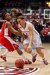 March 21, 2011; Stanford, CA, USA; Stanford Cardinal guard Jeanette Pohlen (23) dribbles past St. John's Red Storm guard Nadirah McKenith (5) during the first half of the second round of the 2011 NCAA women's basketball tournament at Maples Pavilion.