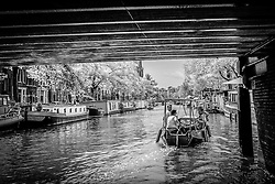 Boating through the canals of Amsterdam, Holland