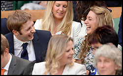 Great Britain's Olympians Laura Trott and her boyfriend Jason Kenny in the royal box at The Wimbledon Tennis Championships<br /> The All England Lawn Tennis Club, Wimbledon, United Kingdom<br /> Saturday, 29th June 2013<br /> Picture by Andrew Parsons / i-Images