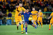 Declan Gallagher (#31) of Livingston FC tackles Demetri Mitchell (#11)  of Heart of Midlothian during the Ladbrokes Scottish Premiership match between Livingston FC and Heart of Midlothian FC at the Tony Macaroni Arena, Livingston, Scotland on 14 December 2018.