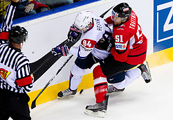 Andrej Hebar of Slovenia vs Mitja Robar of Slovenia during ice-hockey match between Austria and Slovenia of Group G in Relegation Round of IIHF 2011 World Championship Slovakia, on May 7, 2011 in Orange Arena, Bratislava, Slovakia. (Photo By Vid Ponikvar / Sportida.com)