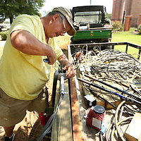 Adam Robison | BUY AT PHOTOS.DJOURNAL.COM<br /> Mike Stokes, an employee's for the Tupelo Parks and Receration Department, works on wiring up an outlet to help power the Christmas decorations purchesed from Fulton resident Jerry Stubblefield at Ballard Park Tuesday in Tupelo.