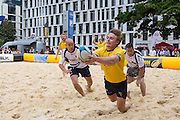 UNITED KINGDOM, London: 31 July 2015 A try is scored during a game of Beach Rugby in the heart of London this afternoon at Finsbury Square. The five-a-side rugby tournament imported 240 tonnes of sand for the event, which sees more than 300 rugby players come together and raise money for Help for Heroes. Rick Findler / Story Picture Agency.